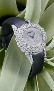 Chopard timepiece made of white gold, the case features pavé marquise-cut diamonds