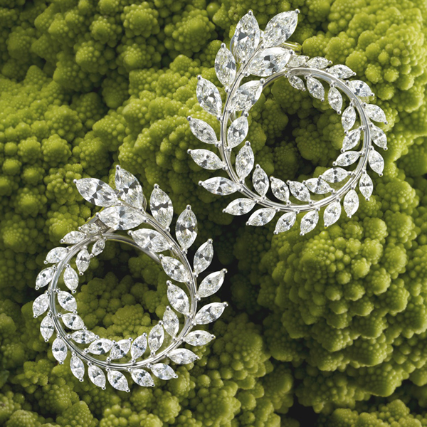 Earrings featuring marquise-cut white diamonds set in a laurel design, crafted in 18-carat Fairmined white gold.