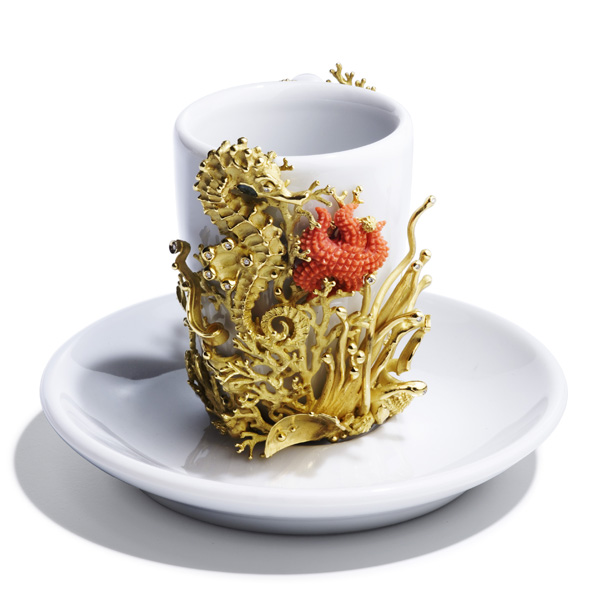 Above, a one-of-a-kind coffee cup adorned with a yellow 18kt gold sea-life motif of seahorse and algae, a starfish engraved in natural coral, and white diamonds.