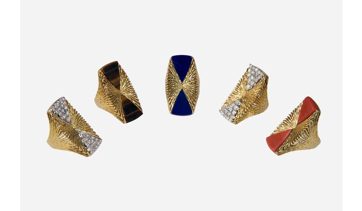 An array of pave-set diamond, Lapis Lazuli, coral, Tiger's Eye rings by Kutchinsky, 1972 and 1973