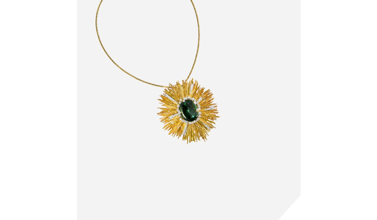 A faceted green tourmaline, diamond and textured 18 karat gold  pendant, on an 18 karat gold torque, by Andrew Grima, 1972