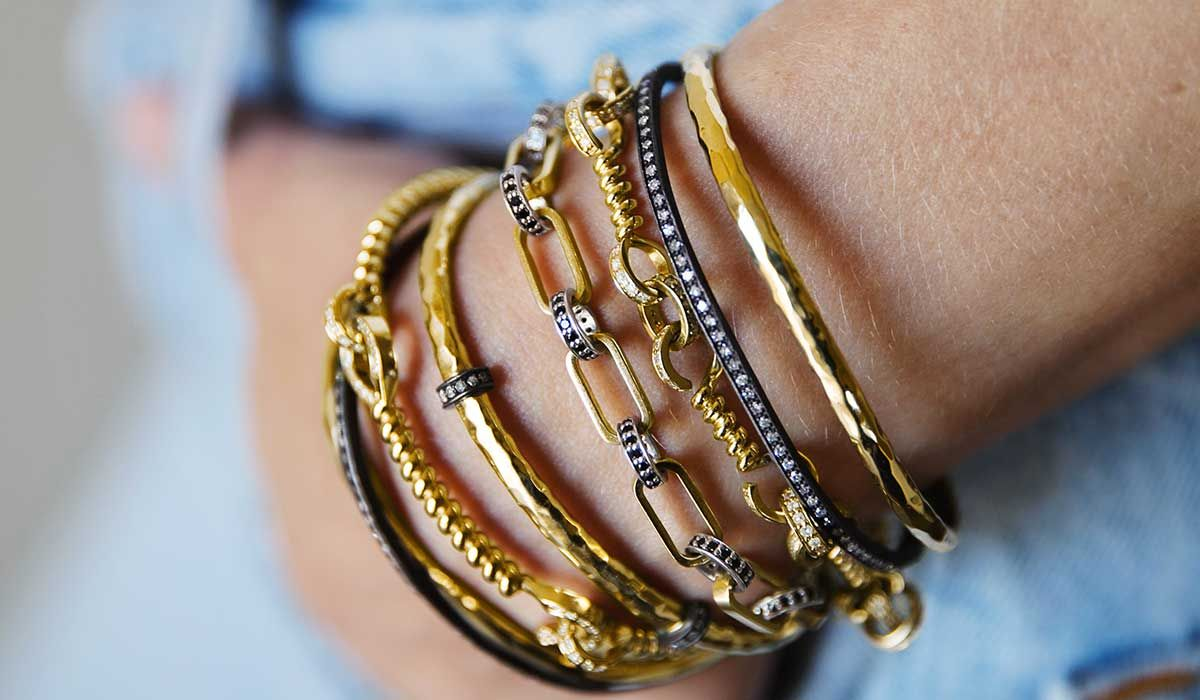 Chain bracelets and bangles in gold or oxidized silver with diamonds, Nancy Newberg.