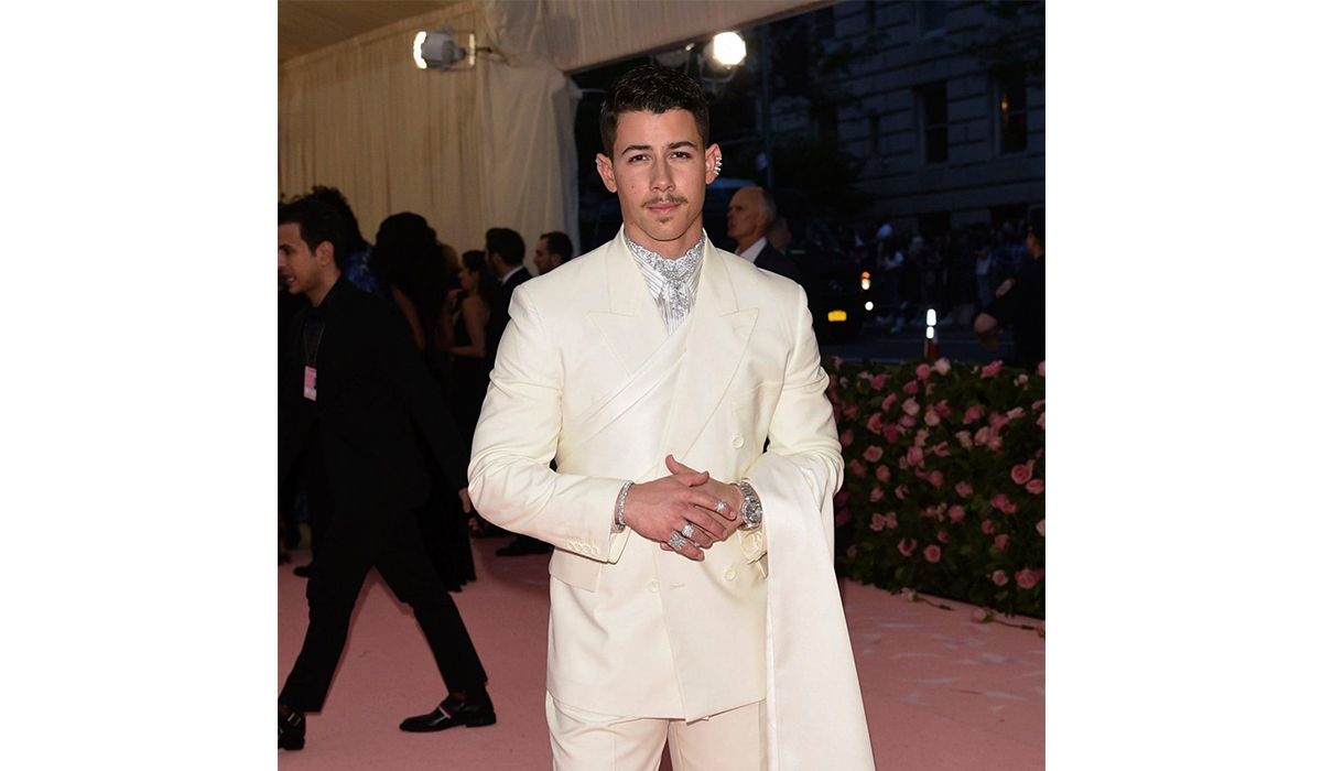Nick Jonas wearing Chopard jewelry