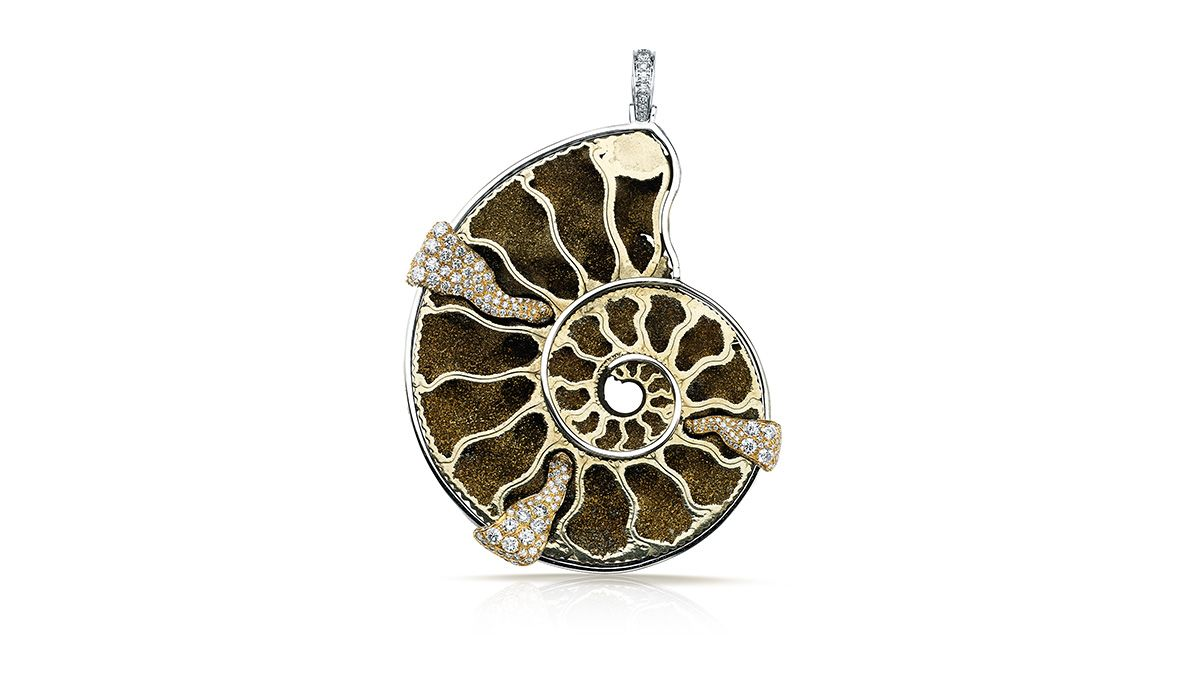 gold pendant with a 111.71ct ammonite fossil in pyrite with an outline of pavé diamonds