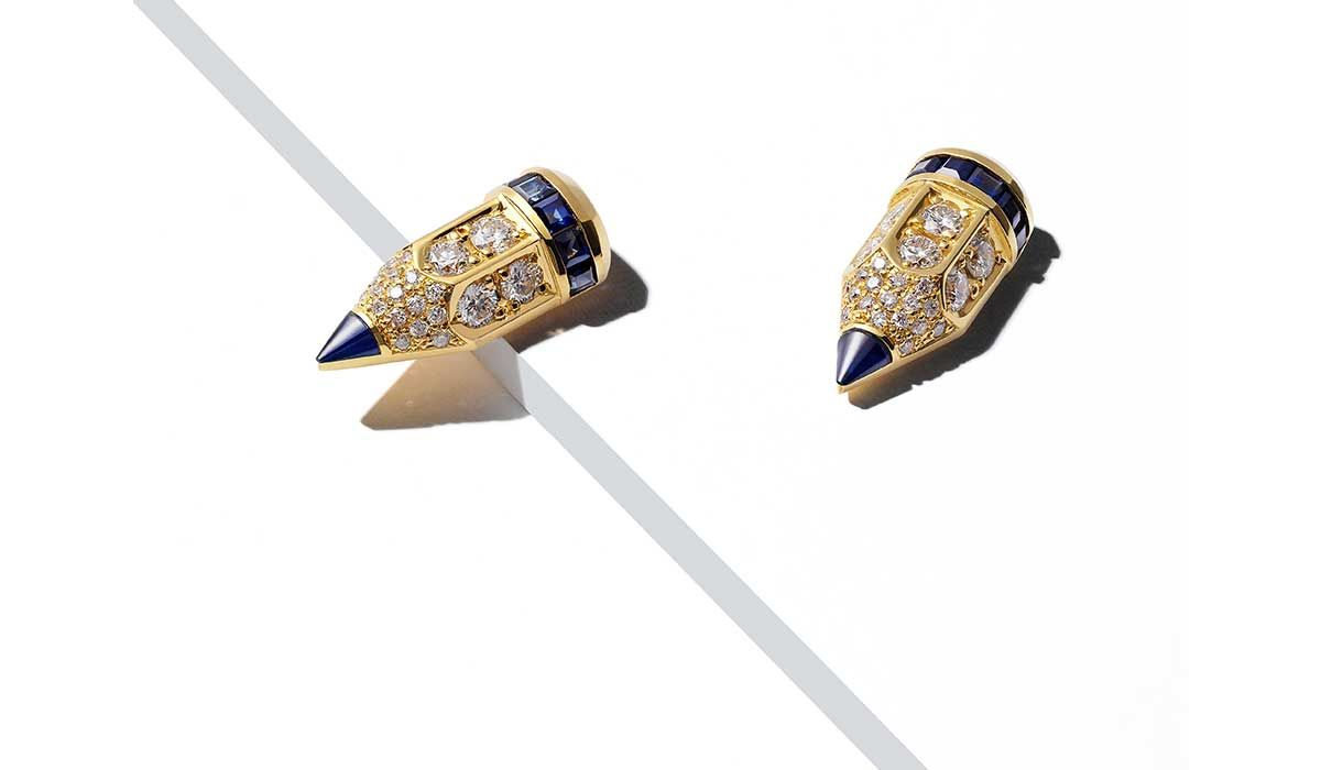 Large stud earrings with blue sapphires and white diamonds.