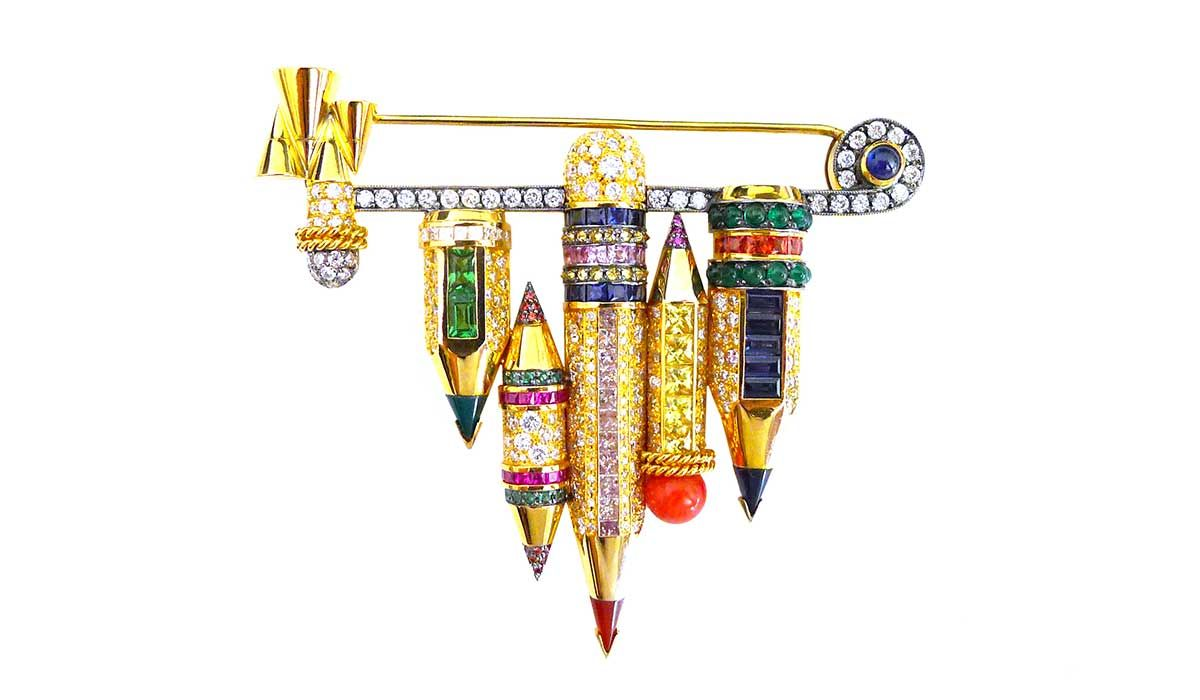 Pencil brooch with multi-colored diamonds and sapphires, emeralds and tsavorites.