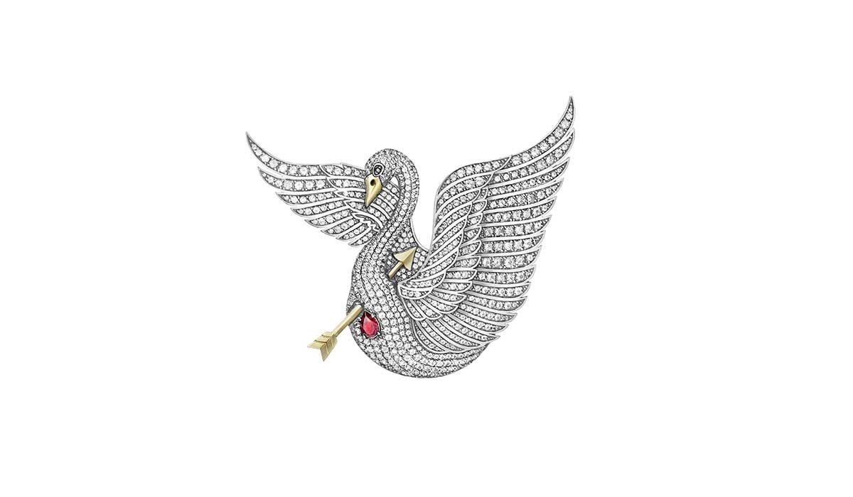 Swan King brooch, in gold and silver with colorless topazes and a ruby.