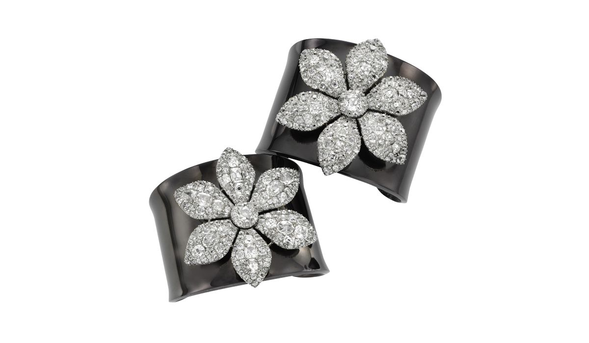 a pair of georgian diamond flower brooches on detachable blackened silver cuffs, 1770 ca