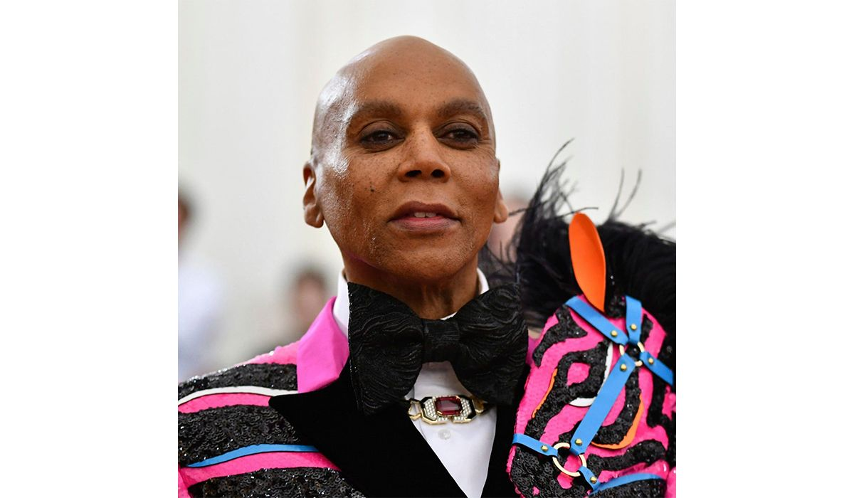 RuPaul wearing a gold diamond, black enamel necklace by David Webb